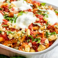 close up of chicken parmesan casserole with fresh herbs and mozzarella