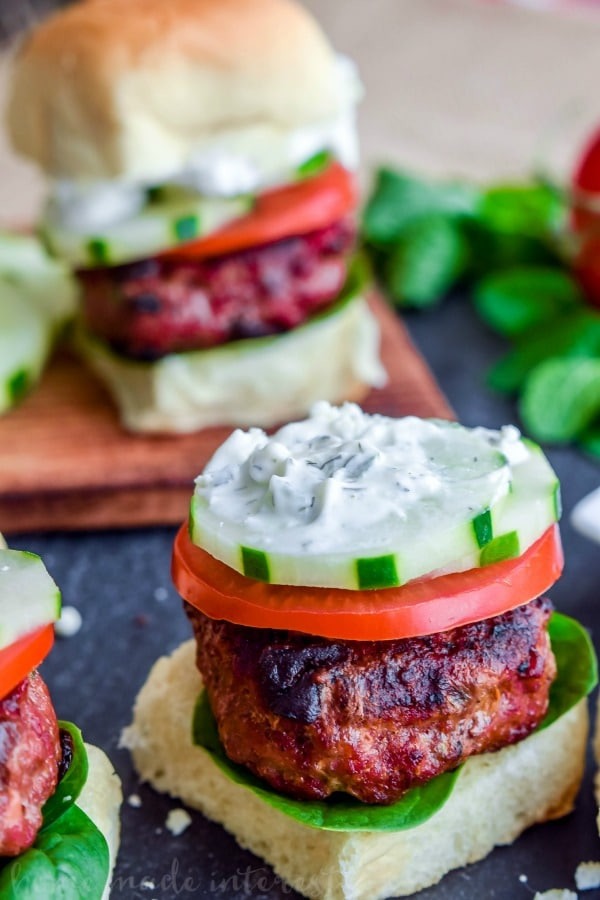 Greek Sliders | These easy Greek Sliders make an awesome appetizer recipe for parties. Make this football party food when you watch the game or serve them as an easy appetizer recipe at a cookout. These grilled Greek sliders are grilled burgers topped with homemade tzatziki to make a delicious slider!