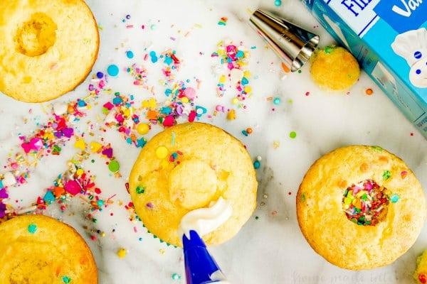 frosting a funfetti cupcake