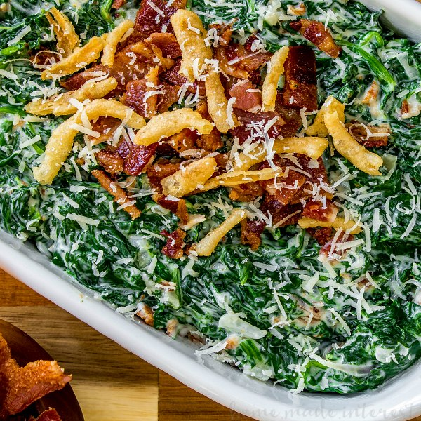 creamed spinach with bacon topped with bacon and fried onions