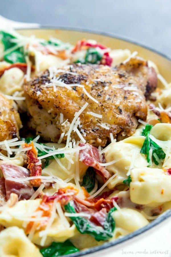 One Pot Creamy chicken and Tortellini chicken thighs in a creamy sauce