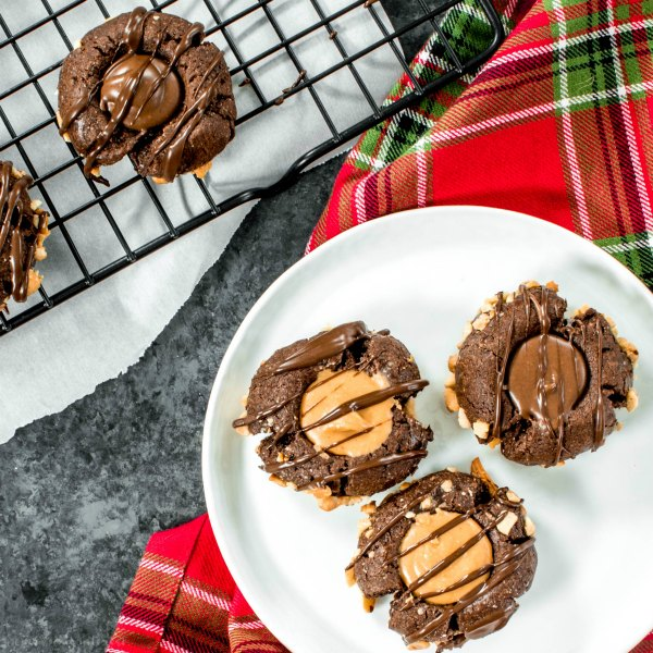 Peanut Butter & Co. Chocolate Peanut Butter Thumbprint Cookies | Christmas thumbprint cookies made with peanut butter