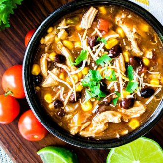 Chicken Enchilada Soup with tomatoes and limes