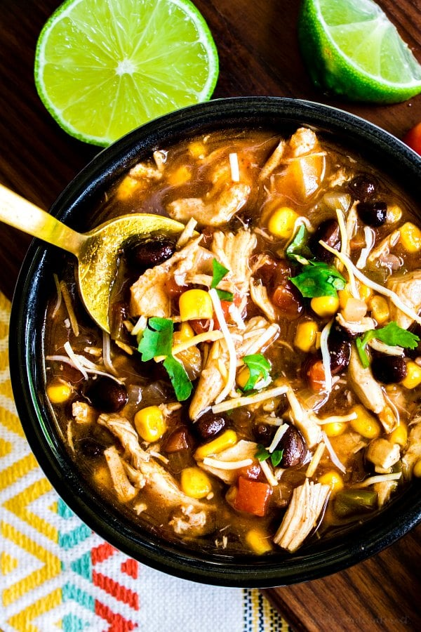 Chicken Enchilada Soup with a gold spoon