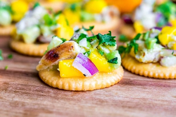 Mango Chicken Salad on a RITZ cracker with fresh cilantro, avocado, and mango
