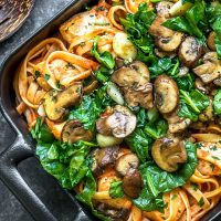 spinach and mushrooms on creamy roasted red pepper pasta