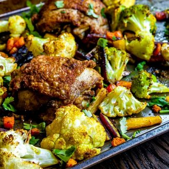Close-up of chicken in Sheet Pan Chicken Curry and vegetables