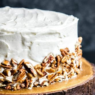 chopped pecans on the side of a Hummingbird Cake