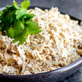 shredded chicken garnished with parsley