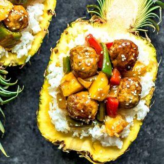 Pineapple Teriyaki Meatballs with rice in a pineapple bowl