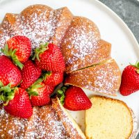 sour cream pound cake topped with fresh strawberries