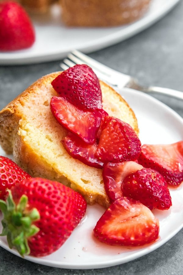 sliced strawberries on pound cake made with sour cream