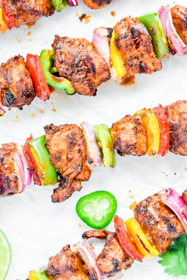 grilled chicken fajita skewers with peppers and onions