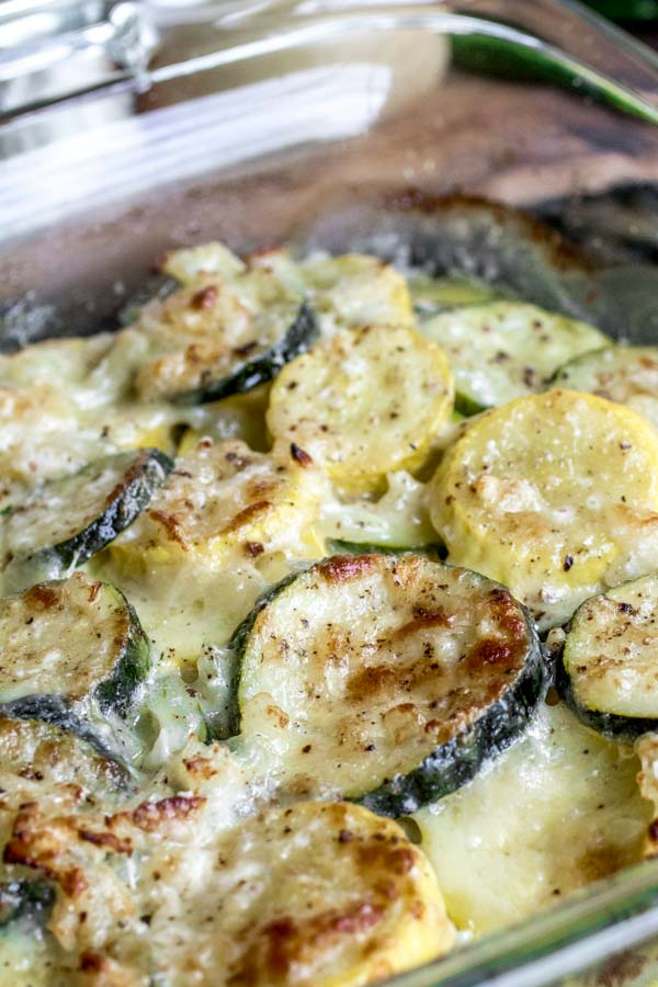 Close-up of Cheesy Baked Zucchini Casserole with melted Gruyere cheese and Parmesan cheese