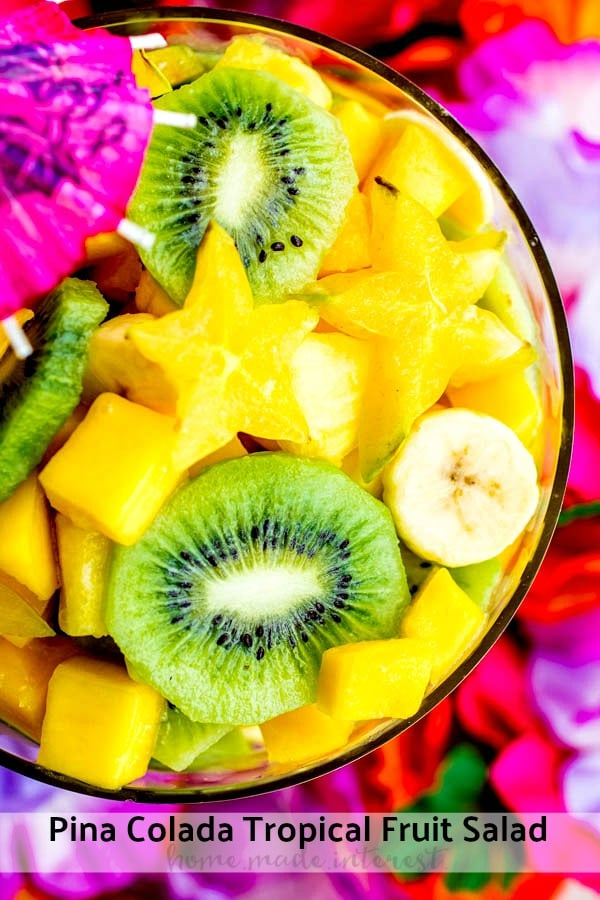 Pina Colada Tropical Fruit Salad is a mix of tropical fruits such as pineapple, kiwi, bananas, mango, and start fruit, tossed in a sweet and tangy coconut lime dressing. It is an easy fruit salad that is the perfect side for a potluck!#fruits #coconut #picnic #sidedish #tropical #homemadeinterest