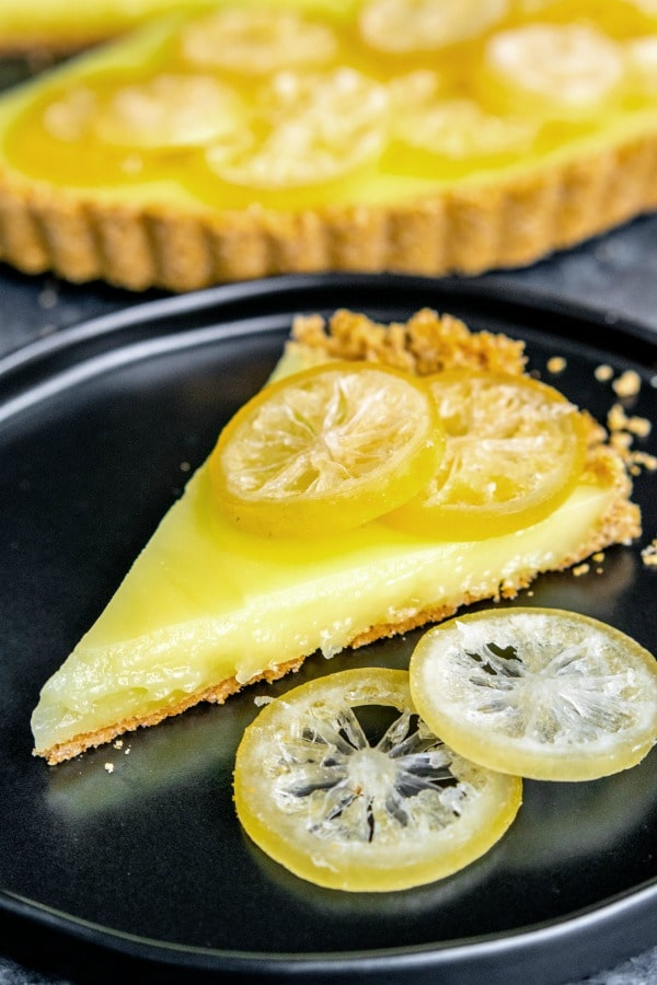 slice of a 7UP Lemon Tart with candied lemon slices