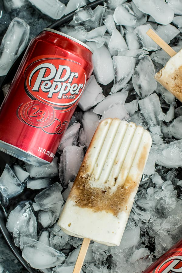 Dr. Pepper Popsicles in a tray of ice with a can of Dr. Pepper