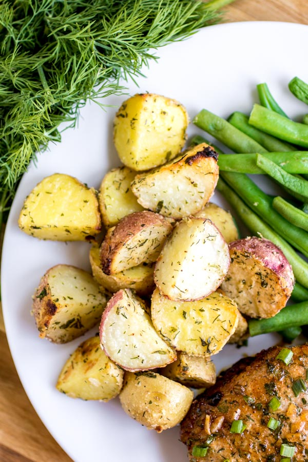 Roasted Ranch Potatoes on a white with green beans