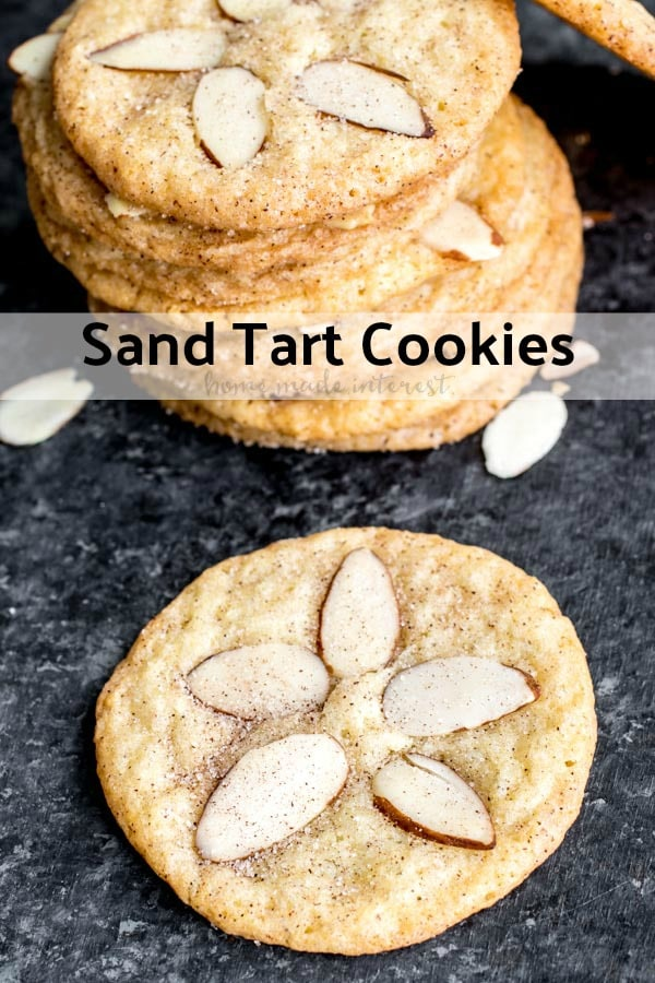 Sand Tarts are thin, crisp, buttery, cinnamon sugar cookies with almond slices on top. This Sand Tart recipe is a Pennsylvania Dutch, or Amish cookie recipe your whole family will love. Make this classic christmas cookie recipe for the holidays and share with friends and family. #cookies #christmascookies #cinnamon #baking #sweettreats #homemadeinterest