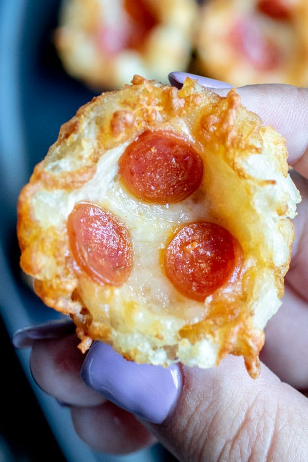 holding Pizza Tots