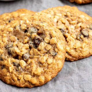 three chewy oatmeal raisin cookies stacked together