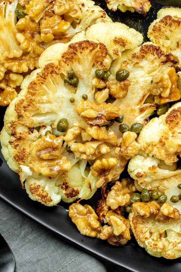 Roasted cauliflower steaks with capers, toasted walnuts, and brown butter