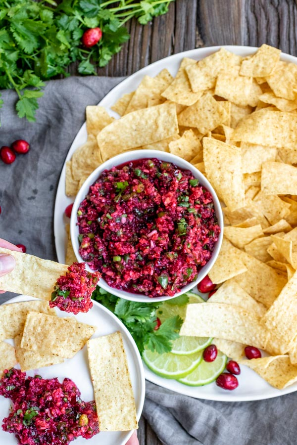 Fresh cranberry salsa on a tray with chips