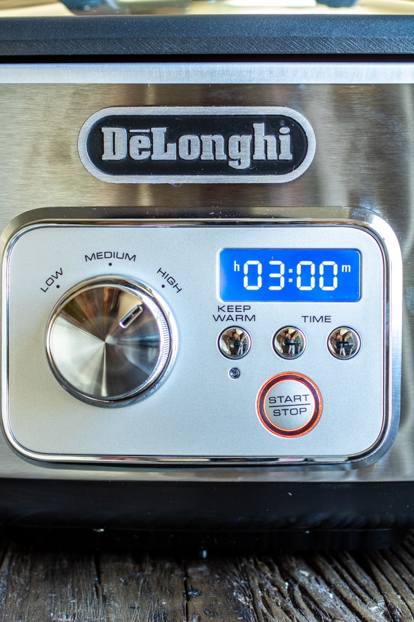 DeLonghi slow cooker set to cook slow cooker spiced nuts