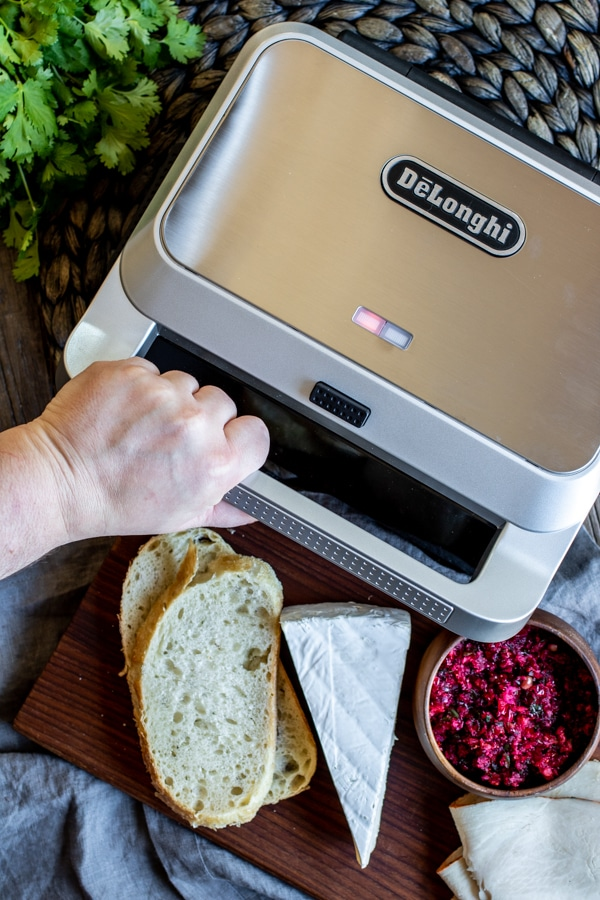 DeLonghi grill pressing and cooking a turkey and cranberry salsa panini