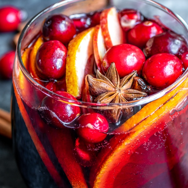Winter Red Wine Sangria filled with fresh cranberries, star anise, and apple slices.