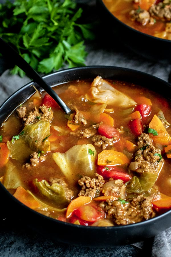 Instant Pot Cabbage Roll Soup on a bowl with a spoon