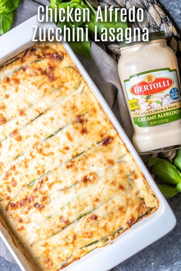 This easy Chicken Alfredo Zucchini Lasagna is a low carb, keto lasagna recipe with chicken and Bertolli Creamy Alfredo with Cauliflower & Milk sauce. Ricotta cheese, shredded chicken, and layers of zucchini noodles topped with creamy sauce and cheese make this a low carb casserole the whole family will love. #alfredosauce #zucchini #chicken #chickenalfredo #lowcarbrecipes #keto #ketodiet #homemadeinterest