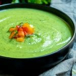 A bowl of fresh, creamy zucchini soup