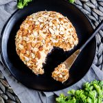 Keto Buffalo Chicken Cheese Ball on a plate and spreader
