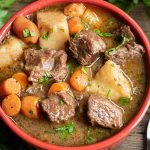 bowl of Instant Pot Beef Stew with beef, potato and carrots